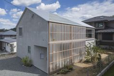World Architecture Community News - Huge corrugated polycarbonate wall lightens a cornered sunroom in house by Tato Architects Architecture Design, Contemporary Architecture, Minimalist Architecture, Outdoor Areas, Outdoor Structures, Internal Courtyard, Minimal Home, Architect House, Japanese House