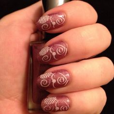 """Nails this week. Base color is another wonderful one from the #Avon Cosmic Collection, this one is called """"Aurora"""". Stamped with Konad Special White using #Pueen plate 41.  #nails #stamping #nailart"""