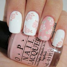 A gentle blend of classic white and light pink shades creates a sense of fragility, femininity. Addition of a hand made floral design with greens emphasises the spring mood. Accents on the ring fingers – the transition between the base and decorative coats creates additional contrast, emphasising the harmony of manicures color gamma. Pattern is easy to do by your own hand.