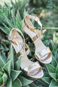 gold wedding shoes by Jimmy Choo - photo by Flora and Fauna http://ruffledblog.com/historic-cree-estate-wedding