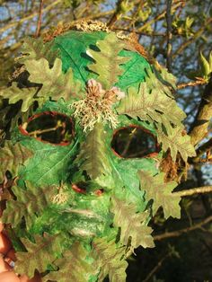 Green man mask. Plaster paper from craft store. In a roll in the clay aisle. Green paint. assortment of leaves and some tacky glue. You will also need some vasoline for your face. Follow directions of package of plaster paper for how to form on your face. Then dry 24 hours and start to get creative