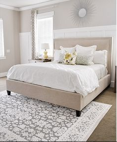 board and batten on focal wall | headboard| wall colors and patterns of rug/drapes