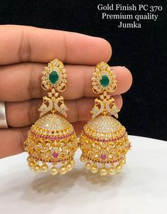 Stunning one gram gold jumkhis studded with pink and white color CZs. - Stunning one gram gold jumkhis studded with pink and white color CZs. Gold Jhumka Earrings, Indian Jewelry Earrings, Jewelry Design Earrings, Gold Earrings Designs, Gold Jewellery Design, Ear Jewelry, Bridal Earrings, Jewelry Art, Silver Jewelry