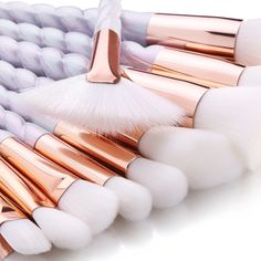 Inspired by a unicorn's horn, this gorgeous 10 piece makeup brush set comes with all the essentials for creating a flawless airbrushed finish. Each brush is made from soft cruelty free fibers. With beautiful gold accents and a shimmering white handle, th Unicorn Makeup Brushes Set, Eye Makeup Brushes, It Cosmetics Brushes, Airbrush Makeup, Makeup Tools, Skin Makeup, Makeup Cosmetics, Unicorn Brush, Cosmetic Brushes