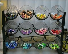 Wine rack to hold plastic cups for markers, pens and pencils, etc.