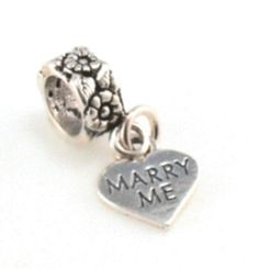 Pandora charm. So sweet......Would be a cute way to ask!!