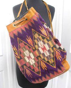 http://www.ebay.com/itm/Vintage-Leather-Trimmed-Sling-Kilim-Bucket-Bag-Chimayo-Tapestry-Backpack-/111648506491?pt=LH_DefaultDomain_0
