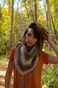 Boho triangle scarf, crochet triangle scarf, handmade triangle scarf with tassels, crochet shawl, crochet scarf, crochet wrap, womens scarf  This Triangle scarf is the perfect fall accessory. Wear it as a scarf or a shawl. Its a mix of cream and brown colored yarn with tassels on the bottom. This scarf was handmade by me in a clean and smoke-free environment. To return to my shop click here: https://www.etsy.com/shop/EvelynAndPeter  To view other scarves click here: https:...