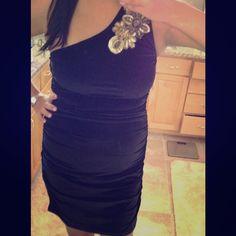 Black one shoulder velvet dress. This is a beautiful dress. It has nice bead and sequin work on the right shoulder.  It has a velvet feel to it. From the middle of the dress all the way to the bottom is 32 inches. Arden B Dresses