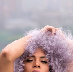 Purple afro is possibly the coolest hairdo ever. x