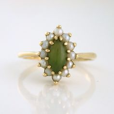 Jadite and Pearls vintage Marquise Ring, 14k yellow gold circa 1950s by SharpFacetsGallery on Etsy https://www.etsy.com/listing/474169747/jadite-and-pearls-vintage-marquise-ring