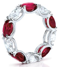 Cellini Jewelers Oval-shaped rubies and diamonds alternate in a handmade, shared-prong, platinum setting. Custom sizes available.