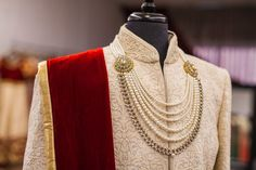 You can choose to flaunt a long gold chain or a beaded neck-wear that will accord a finishing touch to your wedding-day kurta or sherwani and give an elegant minutia to it. Wedding Dresses Men Indian, Wedding Dress Men, Sikh Wedding, Wedding Suits, Sherwani Groom, Mens Sherwani, Wedding Sherwani, Groom Outfit, Groom Dress