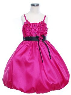 Absolutely adorable dress with beautiful daisys covering the bodice. Black sash is attached at the front with a ribboned daisy for an accent.