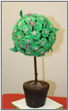 Topiary featuring cupcakes and edible strawberry blossoms.    www.acakedream.com