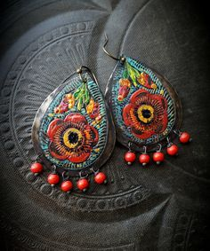hand painted brass stamping flowers in bursting colors with an old world finish, these have been patina darkened first and then completely hand painted and sealed by me. You will fall in love with the way these look on...guaranteed, attention getters with compliments to boot!  Approx 2 total, finished off with brass ear wires and rounds of red stone.  Super light, colorful and bursting with character. Do you have a pair of these in your collection? this is my original design, only at Yucca…