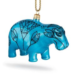 Our whimsical glass ornament celebrates a small hippopotamus statuette (ca. 1961-1878 B.C.) in The Met collection.