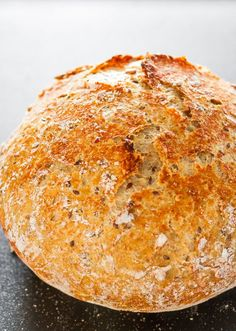 Sunflower and Flax Seeds Whole Wheat Cast Iron Bread - no kneading required and only a few ingredients turn into a super crusty delicious bread. Dutch Oven Bread, Dutch Oven Cooking, Dutch Oven Recipes, Baking Recipes, Flour Recipes, Chef Recipes, Cooking Bread, Bread Baking, Cooking Lamb