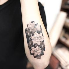 Lotus flowers on the forearm.