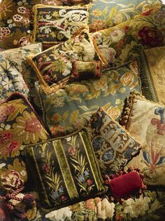 Tapestry and needlepoint cushions.
