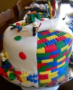 Lego cake. that's CRAZY. its all made of cake acsept the lego guy at the top. i LOVE it