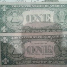 One dollar bill from 1939 and another from 1957