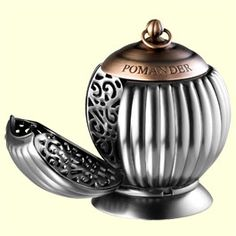 L'Occitane's Pomander is a metal globe that fans out in four elegant segments, each to contain a solid perfume cube.