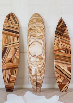Kelly Wearstler, Mulholland Surfboards - Inspired by Kelly's love of Malibu Surf Culture, these unique decorative surfboards bear the name of the famously winding California road, Mulholland Drive. The handcrafted puzzle design features a spectrum of rich woods in Walnut, Cherry, Koa, Ash, Thermowood Ash, Russian Birch Plywood, Douglas Fir, Wenge, White Oak, and South American. A soulful and spirited homage to iconic West Coast Style. http://www.kellywearstler.com