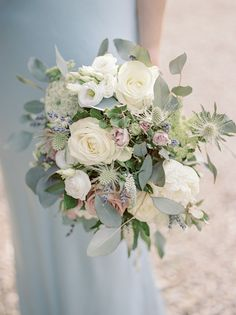 White and purple wedding flowers. Photography by Georgina Harrison