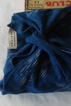 Furoshiki wrap Indigo handwoven teatowel....I'll never forget sitting at lunch at a trade show w/ a Japanese woman who brought her lunch wrapped like this