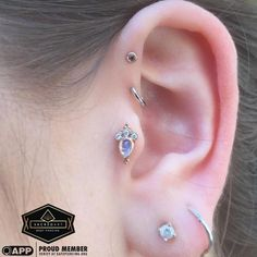 The Star Of The Show , Tragus Piercing With A 14K Rose Gold Pear Sarai With Rainbow Moonstone From Body Vision Los Angeles And A Double Forward Helix With A Rose Gold Bezel Set Moonstone And Tiny White Gold Seam Ring. All Healed !  @safepiercing @bvla #app #appmember #tragus #piercing #gold #rosegold #bvla #sacredart @sacredartbodypiercing #newcastle