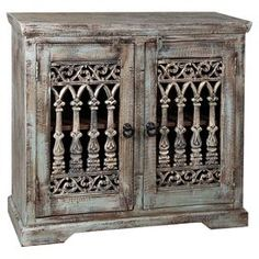 """Weathered green sideboard with two ironwork-panel doors and adjustable interior shelving.  Product: SideboardConstruction Material: Reclaimed wood and ironColor: Weathered greenFeatures:  Two doorsAdjustable shelves for interior storageDecorative hardware Dimensions: 34"""" H x 35"""" W x 14"""" D"""
