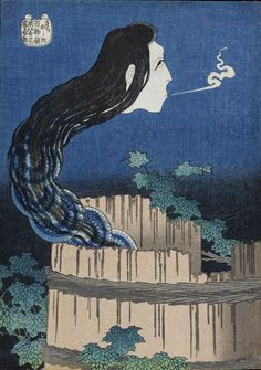 """Here, a woman's head with a serpentine neck made up of a stack of dishes represents the ghost of Okiku, whose master threw her into a well because she had broken his favorite dish. At night the sound of smashing porcelain and a voice counting """"one, two, three…"""" emanated from the well."""