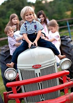Really cute photo idea for all of the grand kids on Papa's tractor.