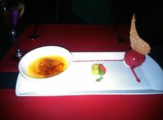 Going to Chile? Don't forget to ask for a dessert like this! El postre, Crema catala y helado de framboesa! HuuuMMm! #Chile #LocalFood