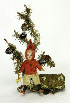 German Candy Container with Bisque Head Doll c.1900 $850 . http://www.ebay.com/itm/Antique-Early-German-Christmas-Candy-Container-With-Bisque-Head-Doll-ca1900-/161574236141?hash=item259e932fed&pt=LH_DefaultDomain_0&nma=true&si=qUuC3Ws0LeLcz5%252FAeI6oHjAI3J8%253D&orig_cvip=true&rt=nc&_trksid=p2047675.l2557
