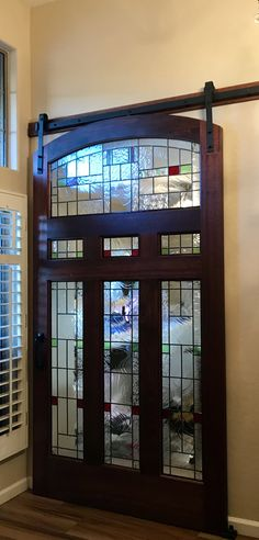 Barn door with stained glass. Custom made. We love how our project turned out!