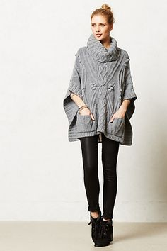 The poncho look is real cute. I like the cables but could do without the little balls. Also like the cowl neck.