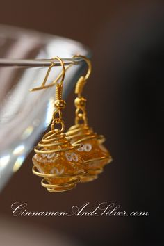Yellow and Gold Wire Wrapped Gamer Dice Earrings, Caged Gamer Dice Earrings, Caged D&D Dice, Dice Earrings, Dice Jewelry by CinnamonandSilver on Etsy  Bunches have been sold already, get yours custom made!