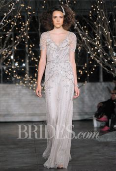 "Brides.com: . ""Marion"" beaded organza sheath wedding dress with a v-neckline and short sleeves, Jenny Packham"