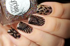 de briz: Illyrian Polish Winter is Coming Collection and stamping with UberChic Beauty. I love this nail art. Glitter with black nail stamps is just the perfect amount of dazzle! #nailart #nails #uberchic #uberchicbeauty #nailaddict #black&gold
