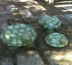 """TerraCotta Turtles! aucer for body, small pot or flat-side wood ball for feet (depending on size), lg wood ball for head. Paint w/ Deco Arts Outdoor Patio Paint, Fern Green. Cut small rectangular pieces of sponge abt  1"""" x 1  1/2"""" & cut corners off, Dip damp sponge in Light Sage Green & edge with paintbrush in Sprout Green paint, paint shell pattern. Use E6000 to put together (hot glue can hold head till dry. Black & white paint for face features."""