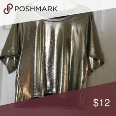 Metallic top Metallic gold/silver top from Charlotte Russe. Lined on the inside to make very wearable. NEVER WORN Charlotte Russe Tops Blouses