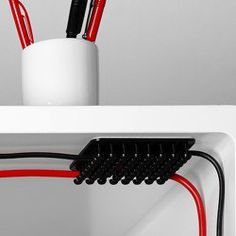 Tangled power cords don't stand a chance against this Cablox Cable Organizer!