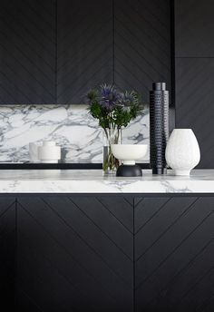 This dramatic black and marble kitchen pairs timber with natural stone. | Greg Natale shares the 5 most common kitchen design mistakes | Image courtesy of Greg Natale