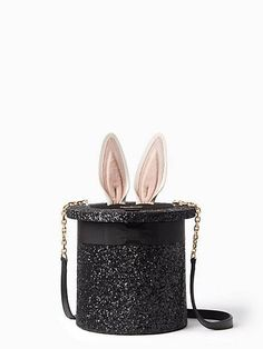 neat trick: tug on the ears affixed to this glittery hat-shaped bag to reveal a surprisingly room interior.