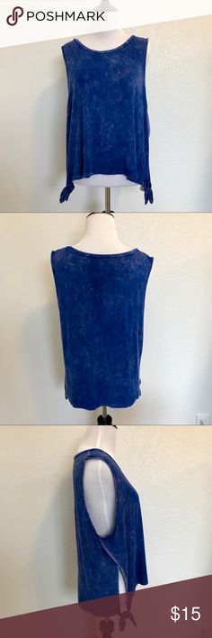 🆕 AMERICAN EAGLE Blue Soft & Sexy Tank Top SZ XL AMERICAN EAGLE Blue Soft & Sexy Tank Top SZ XL  Unique blue tie-dye wash! 🦋 This tank top is made of American Eagle's Soft & Sexy jersey for comfort and style. Soft & Sexy is washed and treated for a one-of-kind look and feel.  - 95% Viscose / 5% Elastane - Relaxed, flattering fit  Check out my closet for more Soft & Sexy tees and tanks! American Eagle Outfitters Tops Tank Tops