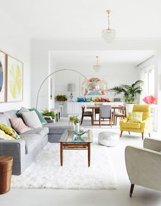 I like the grey scale with the pops of color. I don't want my home to look quite so white-washed tho. I'd like it to be a little warmer than this.