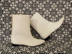 """Go Go Boots 1960s -Wikipedia """"Female dancers on the TV shows Hullabaloo and Shindig also wore the short, white boots"""".  Later on these boots got taller and taller, but we had the short chunky flat heeled ones like these - and loved them!"""