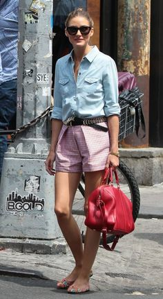 Olivia Palermo in a light blue denim shirt by 7 For All Mankind, short pants, red leather bag by Louis Vuitton and black sunglasses by Westward Leaning in New York City. July 24, 2013.